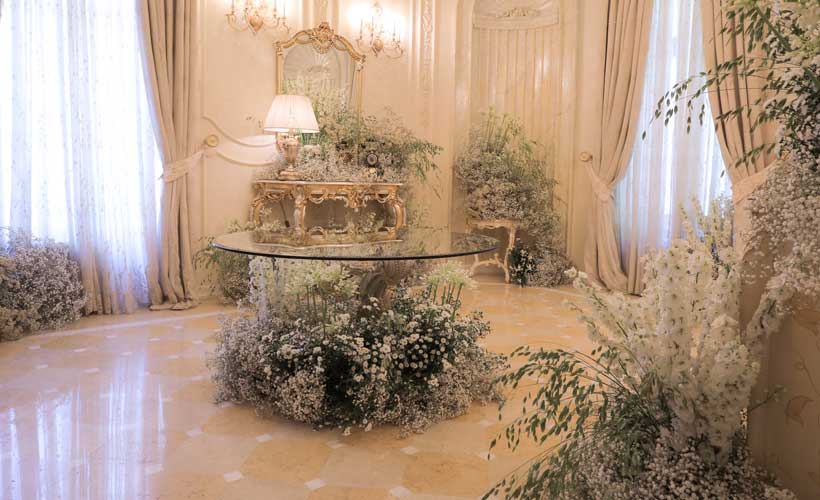 luxury event florist London indoor white flower installation at a castle