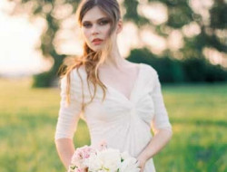 Destination Wedding Planner with bride and bridal bouquet in field