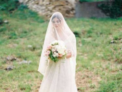 Destination Wedding Planner with bride and veil in castle