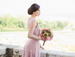 Destination Wedding Vienna, bride with flowers in belvedere palace wearing anelia peschev