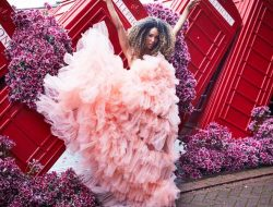 girl with peach dress at London phone box with flowers for Floral Fashion Editorial, styled by Luxury event florist