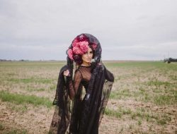 model with black dress, veil and flower crown