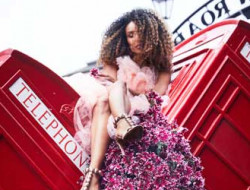 girl on London phone box with flowers for Floral Fashion Editorial