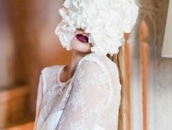 Floral Fashion Editorial with model and flower mask made by a luxury wedding florist in london