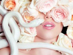 Floral Fashion Editorial with model, roses and snake