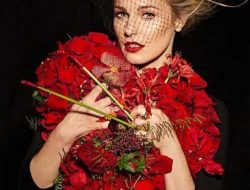 blond model with red flower heart