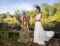 Floral Fashion Editorial with two models at a lake and flower wings