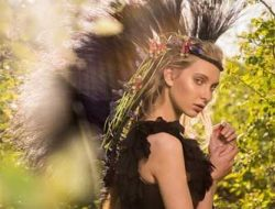 model in jungle with floral accessories