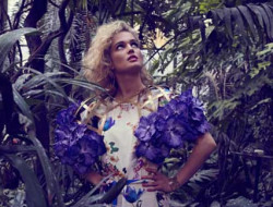 model in jungle with floral shoulder piece