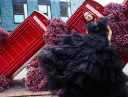 girl with black dress at London phone box with flowers for Floral Fashion Editorial, styled by Luxury event florist