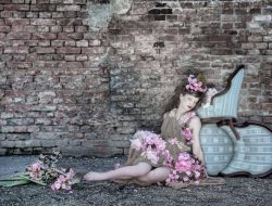 girl on the floor with chairs and flowers styled by BOLTE Luxury Event Design