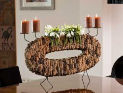 christmas flower arrangement with pine cones and candles for luxury christmas event