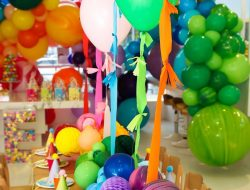 Luxury children's party decoration ideas with colourful mixed balloons and flowers