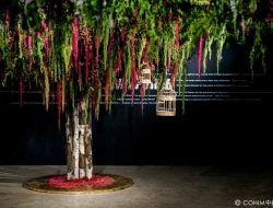 chinese party with indoor tree installation made of flowers