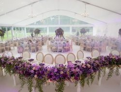 indian wedding in uk low table runner with violet flowers