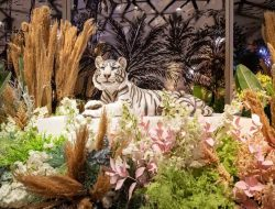 exotic party decoration with flowers, mirror and tiger for london party