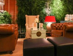 luxury event florist london green floral wall with oriental lounge furniture