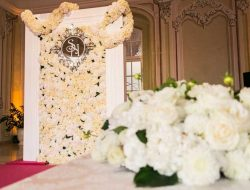 white flower wall with monogram from luxury event florist london