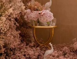 pink flower installation with birds for dubai party planner