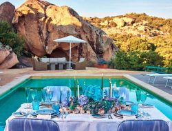 private pool party at the costa smeralda with event flower installation