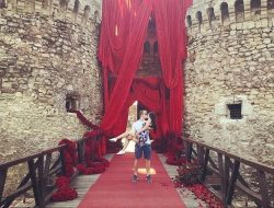 castle with flower garlands for a romantic Surprise Marriage Proposal