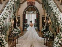 bride with floral staircase at luxury wedding planned by Wedding planner france